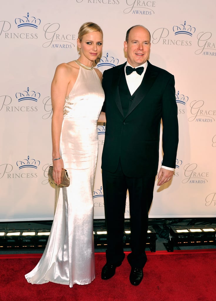 Princess Charlene and Prince Albert of Monaco are in the US! The Monégasque royals were in NYC last night for the 30th Princess Grace Awards gala, which was held at Cipriani 42nd Street. Last year's event brought out Anne Hathaway to honor Julie Andrews, Anne's The Princess Diaries costar. The 2012 bash honored other prominent individuals in drama, dance, and film. The Princess Grace Foundation annually hands out scholarships to help artists early in their careers.  Last night, we got to watch as the prince and princess entered Cipriani's and mingled with their guests. Many double air-kisses and photographs later, Charlene and Albert took their seats for the gala, hosted by journalist Paula Zahn, to begin. Princess Charlene wore an ivory silk gown, with a detailed halter-neck, to accompany her tuxedo-clad husband around the space as they were welcomed by a Big Apple crowd eager to rub shoulders with visiting royalty.