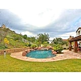 Plenty of room for pool toys and lawn furniture in this lush backyard, situated on the .36-acre lot.