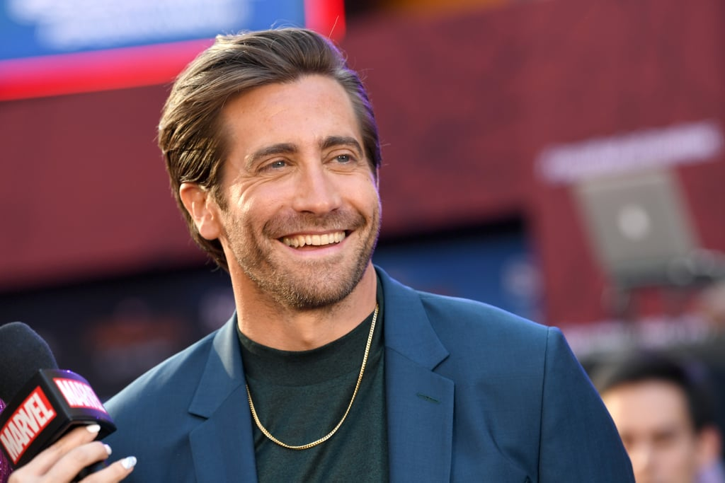 Jake Gyllenhaal, what are you doing to me?! After years of nearly killing me with his piercing blue eyes and scarily captivating good looks, he did it. He put the final nail in my coffin at the Spider-Man: Far From Home premiere in Los Angeles, and it's all thanks to his damn gold chain . . . and navy suit . . . and slicked back hair . . . and smile. The 38-year-old actor, who plays Mysterio in the upcoming movie, pulled up to the TCL Chinese Theatre on Wednesday night with the entire cast of the movie, and they all looked stunning. Jake, of course, had some bromantic moments with his costar Tom Holland, and he also posed for photos with an acrobatic Spider-Man, but it was his mesmerising smile that had me weak. Please enjoy a ton of photos of Jake at the Spider-Man: Far From Home premiere, and prepare to be caught in his web of good looks.       Related:                                                                                                           The Entire Spider-Man: Far From Home Cast Hit Up the Premiere Looking Unbearably Attractive