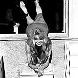 Brigitte Bardot struck a playful pose in 1957.
