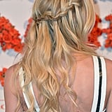 Jennifer Morrison's waterfall braid is the perfect complement to your beachy waves this Summer.