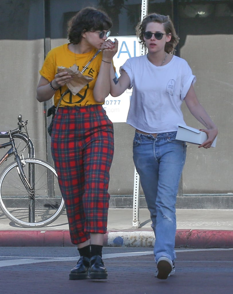 """It looks like things between Kristen Stewart and Soko are heating up! On Friday, the pair was spotted out and about in LA, where they grabbed food and ran a couple of errands. The duo, who first sparked romance rumors in March, held hands and even took turns giving each other kisses. Their low-key outing comes at the tail end of a PDA-filled month for the women. After Soko greeted Kristen with a bouquet of flowers in France, the two flaunted their love all over Paris with a series of sweet outings, including a playful park date. Soko also recently opened up about  how she met Kristen in an interview with WMagazine.com, revealing, """"It was very OG."""" Keep reading to see more of the ladies' day out, and then get to know Soko in five quick facts."""
