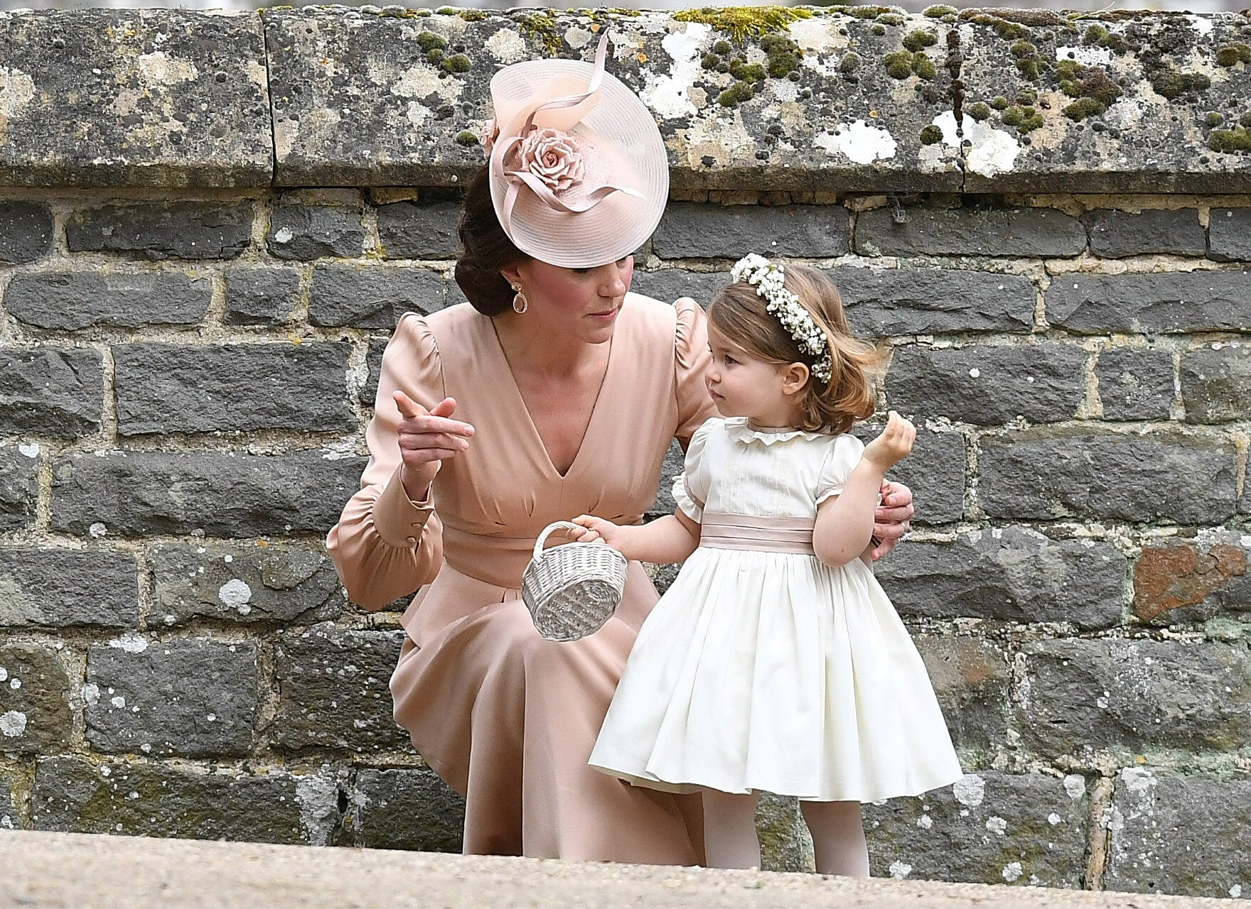 ENGLEFIELD GREEN, ENGLAND - MAY 20:  Catherine, Duchess of Cambridge and Princess Charlotte of Cambridge, bridesmaid leave the wedding of Pippa Middleton and James Matthews at St Mark's Church on May 20, 2017 in Englefield Green, England.  (Photo by Samir Hussein/Samir Hussein/WireImage)