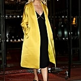 Karlie Kloss Wore a Yellow Satin Duster Coat Over a Black Midi Dress in Paris