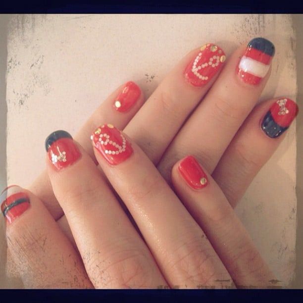 There is no doubt that sailing was on Zooey's mind when she got this nautical-inspired manicure.  Source: Instagram user ZooeyDeschanel