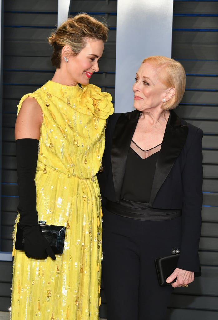 """Sarah Paulson and Holland Taylor turned Vanity Fair's Oscars after-party into a glamorous date night on Monday. The couple, who's been dating since 2015, arrived hand in hand and were as adorable as ever as they exchanged loving glances on the red carpet. They also had a cute reunion with Sarah's American Horror Story co-star Angela Bassett and actress Joan Collins. The last time Sarah and Holland hit a red carpet together was back in June 2016 at a reception honouring Kathy Bates, though they are often spotted taking sweet strolls in NYC. In December, Sarah opened up about her relationship with Holland in an interview with The Edit, saying that several people told her it'd be best if she kept their romance a secret. """"My life choices are, um, unconventional,"""" she said. """"I'm with a much older person, and people find that totally fascinating and odd, and to me, it's the least interesting about me."""" Sarah is 43 and Holland is 75, but when it comes to love, age is just a number, right?"""