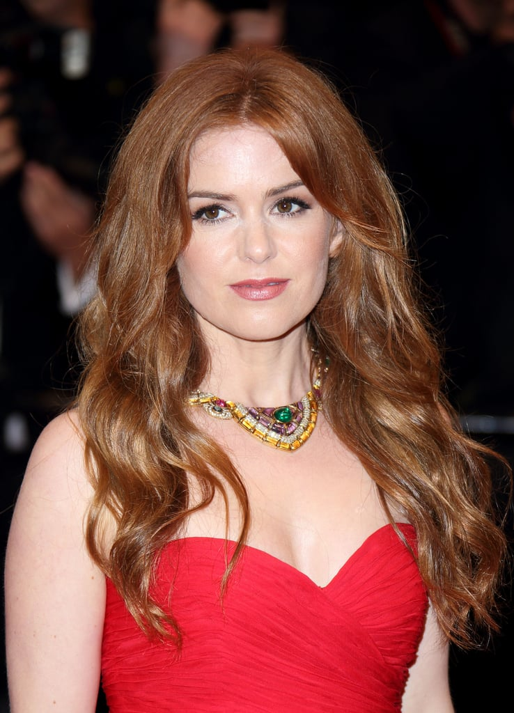 While attending The Great Gatsby premiere at Cannes, Isla Fisher sported some seriously sexy waves. Celebrity stylist Giannandrea started by applying Ecru New York Volumizing Silk Mist ($24) through Isla's wet hair. Once partially dry, he divided her strands into generous sections and completed blow-drying with a large round brush. Next, he curled Isla's hair with large Velcro rollers, setting for 15 minutes. After the rollers were removed, Giannandrea used a Mason Pearson brush to break up the wave.  To finish, he used a one-inch curling iron to perfect the curl, spritzing on the brand's Sunlight Styling Spray ($23) for definition and hold.
