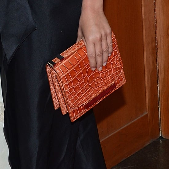 Ashley ditched a purse, but Mary-Kate carried a crocodile clutch from The Row. While her exact bag isn't available online, this The Row python bag ($5,100) has a similar silhouette. For something less pricey, try this House of Harlow croc-embossed clutch ($195).