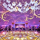 Look closely — this dance floor is completely covered in flowers beneath glass! And flowers projected onto the walls are the icing on the cake at this opulent reception.