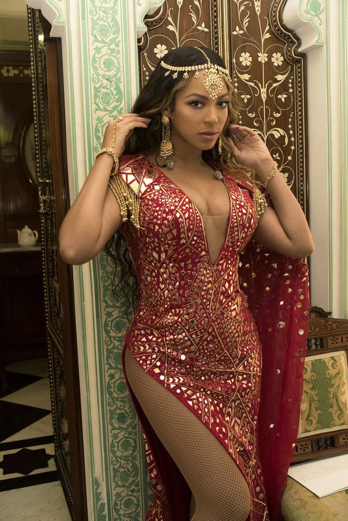 """Beyoncé might be a world-renowned vocalist, rapper, and style icon, but she's also one heck of a wedding singer. On Sunday, the Lemonade songstress put on a stunning performance at the prematrimony festivities of Isha Ambani, the 27-year-old daughter of India's richest man, Mukesh Ambani. Bey belted some of her most popular hits, such as """"Perfect,"""" """"Naughty Girl,"""" and, of course, """"Crazy in Love."""" In true Bey fashion (literally), she wore multiple outfits throughout her set, notably a dazzling red gown with a golden headpiece and drop earrings. Other attendees at the prewedding extravaganza included Hillary Clinton and newlyweds Priyanka Chopra and Nick Jonas. Beyoncé also posted a few gorgeous photos and videos of her at the event, serving up a piping-hot plate of fierceness, as per usual. But keep looking to see even more striking pictures of Queen Bey's performance, and try not to feel too sad that you weren't there — just live vicariously through all the photos and gifs."""