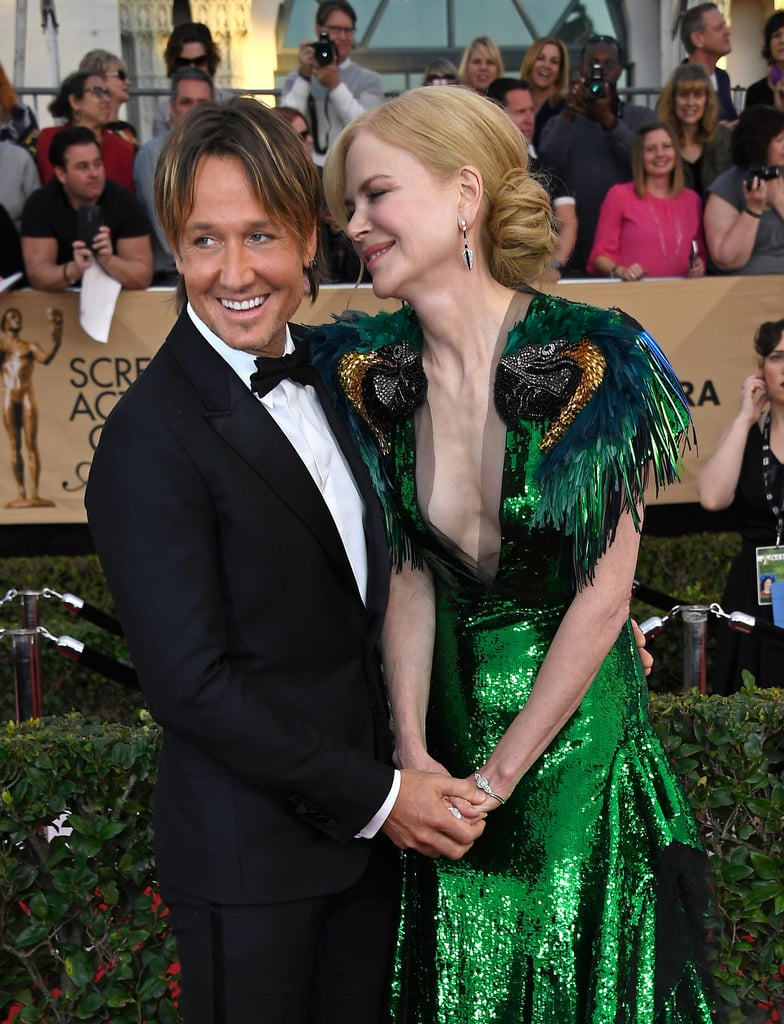 If there's one couple that always manages to leave us green with envy when they hit a red carpet, it's Nicole Kidman and Keith Urban. After pulling double duty and popping up at two high-profile events on Saturday night, Nicole and Keith made their way to the SAG Awards in LA on Monday, where they poured on the PDA. In addition to flashing their winning smiles and exchanging sweet glances, the couple of 11 years held hands as they made their way inside. Nicole stunned in a gorgeous Gucci gown, while Keith kept things dapper in a black tux. We just can't get enough of their romance!       Related:                                                                Sofia Vergara and Joe Manganiello Only Have Eyes For Each Other on the Red Carpet                                                                   Chrissy Teigen and John Legend's SAG Awards Outing Will Give You the Warm and Fuzzies