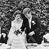 Their wedding cake was massive. The five-tiered cake, which was a gift from John's dad, Joseph P. Kennedy, was four feet tall and included a beautiful display of flowers.