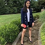 The outfit: I wore an Everlane tee underneath my Sandro double-breasted blazer. I styled it with my Good American biker shorts, Dior kitten heels, a Chanel wallet, and Quay sunglasses.