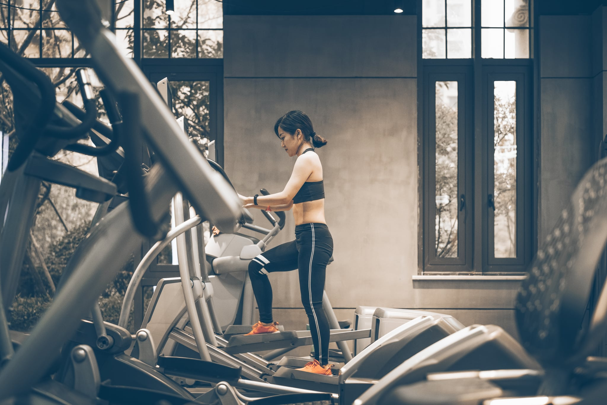 Keep Your Stride With These Elliptical Workouts, From Beginner to Advanced