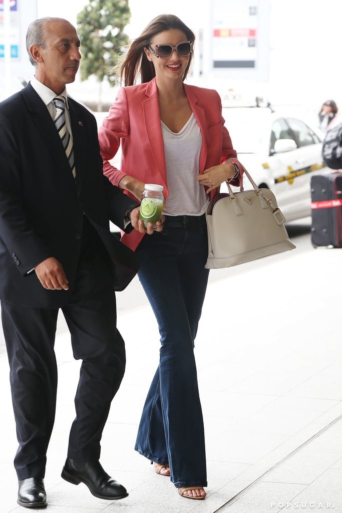 Miranda Kerr arrived at the airport in Sydney looking ready for Spring in a bright blazer yesterday. She was in her native Australia fulfilling her duties as a Qantas global ambassador. Miranda modeled the airline's new uniforms and dressed up for a gala dinner with fellow ambassador John Travolta and his wife, Kelly Preston. Miranda also revealed a collaboration with the Australian company and her own Kora Organics line, which is now being sold online through Qantas's frequent-flier store. It looks like she has plenty to keep her busy despite no longer being under contract with Victoria's Secret, and she'll have even more on her plate tomorrow, when she celebrates her 30th birthday.