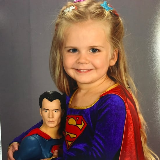 Little Girl Dressed As Supergirl For School Photo