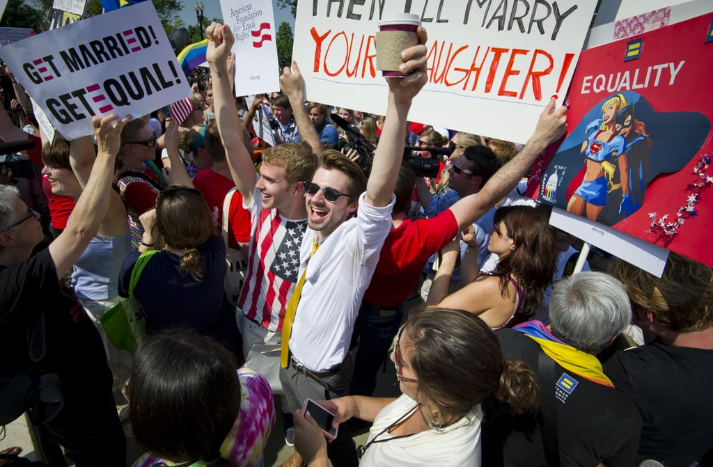 Gay rights activists cheered and raised their arms in victory after DOMA was declared unconstitutional on Wednesday.