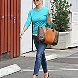 Reese Witherspoon wore jeans and a bright blue sweater during an outing in LA.