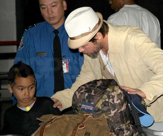 Slide Photo of Brad Pitt and Maddox at JFK Going Through Security
