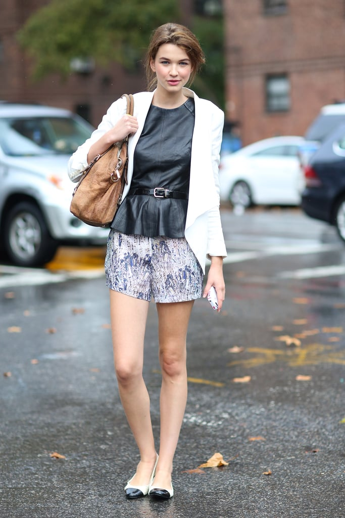 A leather peplum top gave a slick finish to shorts and ballet flats. Source: Greg Kessler
