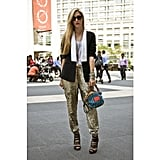 "At New York Fashion Week in September 2011, Joanna Hillman added a graphic blazer and a bright Proenza Schouler bag to sequined J.Crew sweatpants.  Shop the look: <iframe src=""http://widget.shopstyle.com/widget?pid=uid5121-1693761-41&look=4300316&width=3&height=3&layouttype=0&border=0&footer=0"" frameborder=""0"" height=""244"" scrolling=""no"" width=""286""></iframe> Photo: Phil Oh"