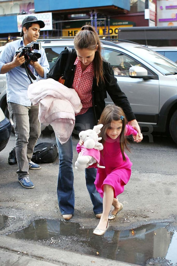 Katie Holmes and Suri stopped by a toy store in NYC this afternoon. Suri got adventurous as she lept over a puddle on her way into the shop, while Katie held onto both her daughter's hand and a fuzzy pink blanket. Suri wasn't around earlier in the day when Katie was spotted out enjoying the warmer Spring weather with her mom Kathleen Holmes, who also made an appearance in the Big Apple yesterday. Kathleen, Katie, and Suri visited a Whole Foods, where they were seen holding hands as they crossed the street.