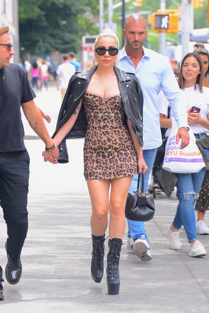 Looking rocker chic in a cheetah print mini dress by Miaou paired with a leather jacket.