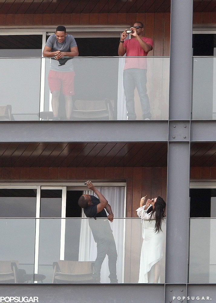 Kanye West and Kim Kardashian took photos of Will Smith on the balcony of his hotel room, which was located directly above the couple's room.