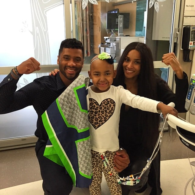 """After making their official debut as a couple at the White House Japanese state dinner at the end of April, Russell Wilson and Ciara are sharing the spotlight again. On Tuesday, Ciara joined Russell at the Seattle Children's Hospital to visit sick kids and their families, and both shared snaps of the philanthropic afternoon on Instagram. While Ciara may have been a new addition, the Seattle Seahawks quarterback is actually a weekly volunteer at the hospital and says that """"all the amazing opportunities I've had on the field can't compare to helping kids whose lives are on the line."""""""