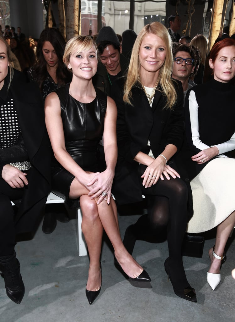 Reese Witherspoon had a huge grin sitting front row next to Gwyneth Paltrow at the Hugo Boss show on Wednesday.