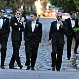 The groomsmen, including Chris Benz with pink hair, in their tuxedos.