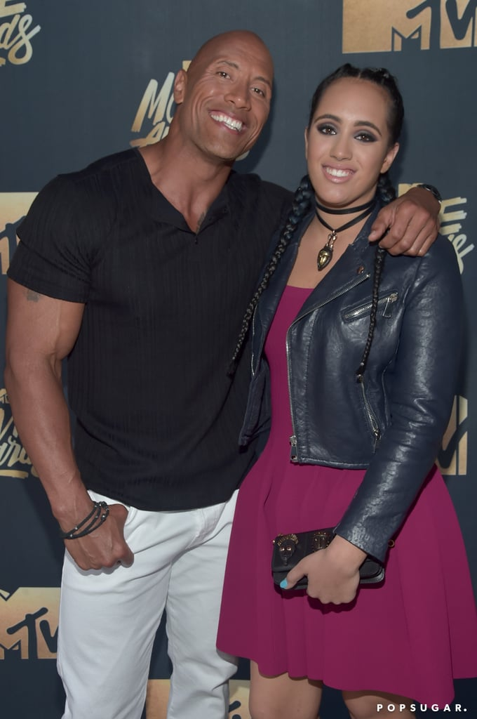 The MTV Movie Awards became family night for Dwayne Johnson, who had the support of his daughter Simone Alexandra and ex-wife Dany Garcia in LA on Saturday night. The actor, who showed off his bulging biceps in a black t-shirt, posed for pictures with his daughter prior to hitting the stage with funny man Kevin Hart. While Dwayne is hosting the ceremony, he is also nominated for best action performance for his role in San Andreas. Last week, he took a break from filming Baywatch and returned to the ring, where he broke WWE records at Wrestlemania 32. Keep reading for more of Dwayne's night, and then check out all the reasons we love him.