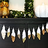 Feather decor is super trendy and perfectly on season for Thanksgiving. This DIY glitter garland is the perfect way to tie in the trend while enhancing your home's natural beauty for your Thanksgiving celebration.