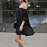 An off-the-shoulder LBD and heels