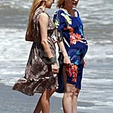 January Jones with a friend at the beach.