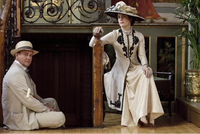 As compared to Victorian styles, Edwardian fashion was looser and less restrictive. That's not to say that clothing was comfortable, though. Cora and her daughters would definitely have worn corsets beneath their clothing, which explains why they needed help dressing. Source: ITV