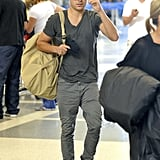 Zac Efron carried a bag over his shoulder as he departed from LAX Airport.