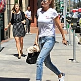 Wearing RtA boyfriend jeans with a white t-shirt and white Adidas Stan Smith sneakers.