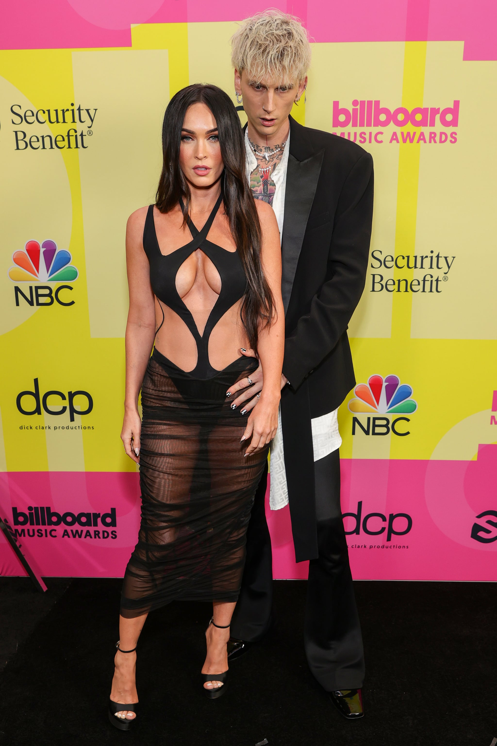 LOS ANGELES, CALIFORNIA - MAY 23: Megan Fox and Machine Gun Kelly poses backstage for the 2021 Billboard Music Awards, broadcast on May 23, 2021 at Microsoft Theater in Los Angeles, California. (Photo by Rich Fury/Getty Images for dcp)