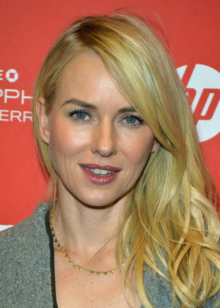 Naomi Watts accessorized her Winter look with a gold pyramid necklace.