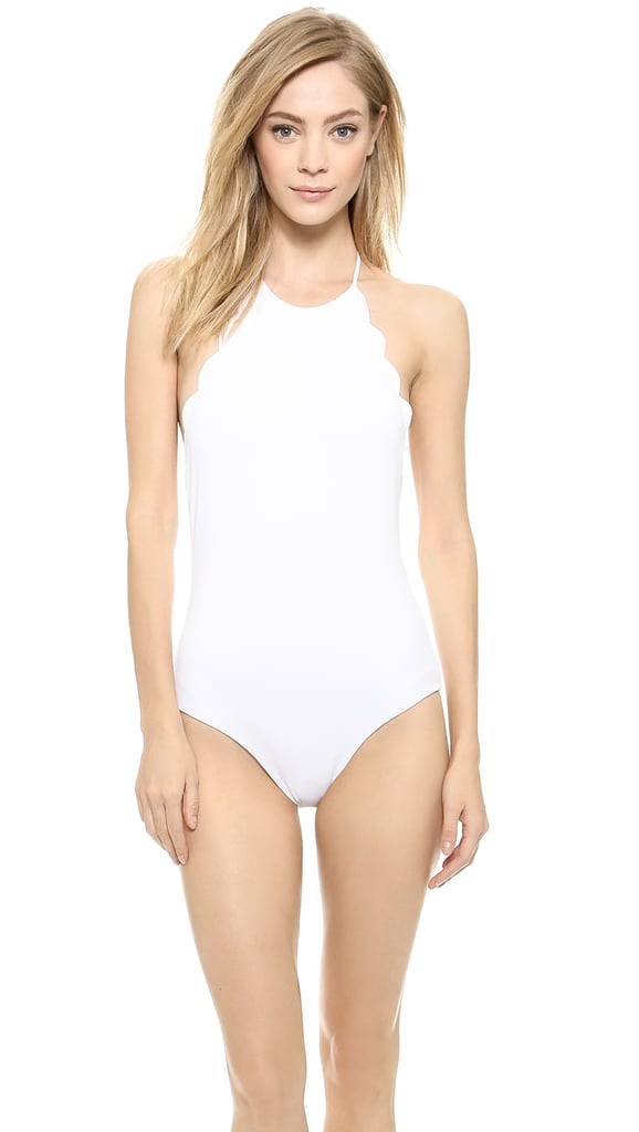 I'm fully embracing the one-piece this season, and this Marysia Halter Malliot ($315) is simple and sleek, with a touch of flirty scalloped edges — not to mention it'll look even better with a tan. — HM