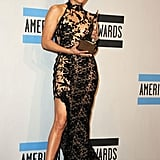 Jennifer Lopez posed with her award for favorite Latin artist.