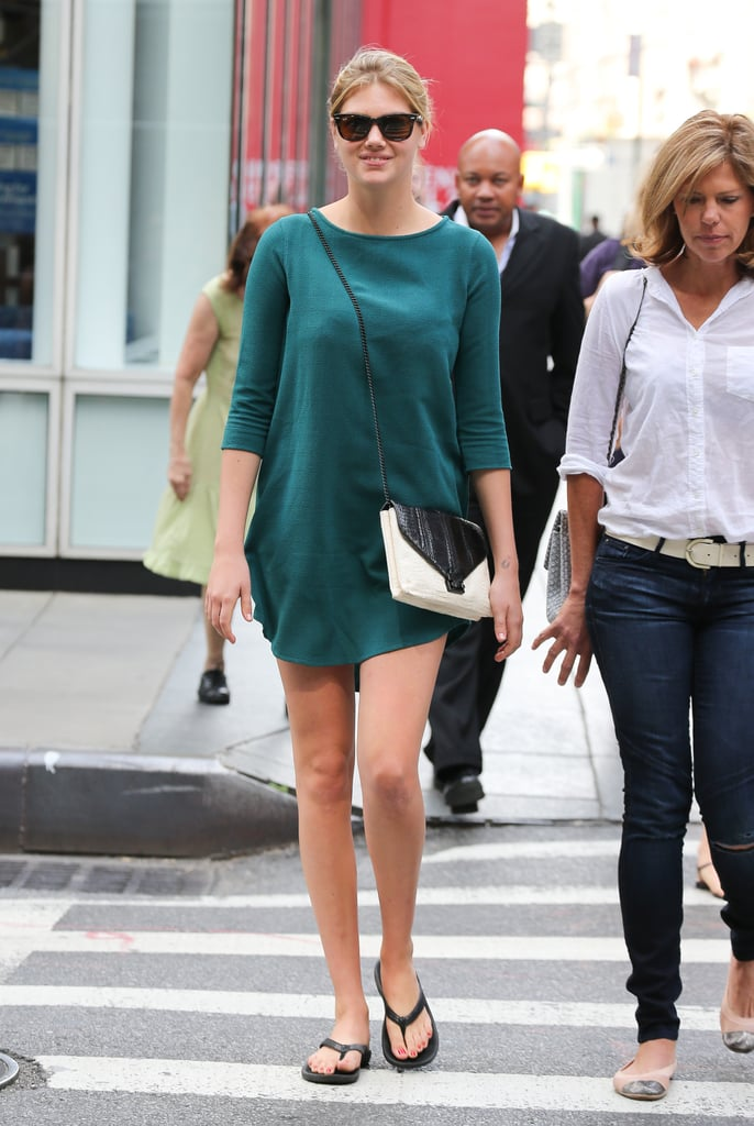Kate Upton stepped out in New York City looking chic and casual in a simple shirt-dress and a monochrome cross-body bag.