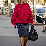 Warm up a pair of long shorts with a cosy sweater.