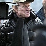 Robert Redford bundled up on set.
