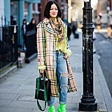 With Ripped Jeans and Neon Green Ankle Boots