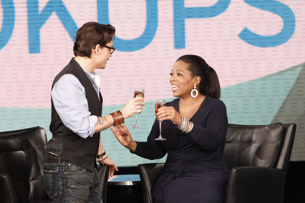 Johnny Depp dropped by Oprah to pay her a visit and toast to her final season, and while there he debuted a sexy short haircut! Johnny apparently brought along an exciting Pirates of the Caribbean: On Stranger Tides surprise, which we'll see when the episode airs tomorrow. Johnny swooped into Chicago to stop by and chat with Oprah while his Pirates costars took care of press junket duties. The whole group will be together this weekend for the world premiere at Disneyland in Anaheim, CA, before heading off to the Cannes Festival and the rest of their worldwide promotional tour!