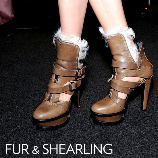 Why we love them: Nothing says warm and cozy like a bit of shearling or fur lining your boots. It lends a slightly rugged, woodsy vibe to any t-shirt and jeans ensemble (think Aspen après-ski or Sundance Film Festival-chic), but can also look unbelievably posh when worn with a flowy dress, as they were at Etro's runway show. How to wear them: For a cabin-cool look, pair your fur-lined boots with a pair of skinny jeans, flannel button-down, and a neutral-toned parka or puffer coat. Not much of a camper? Dress these babies up with a flowy, floral dress and wool coat.   Shop the runway: Etro Fur-Lined Ankle Boots ($1,125)
