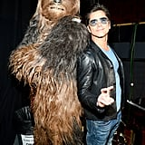 Pictured: John Stamos and Chewbacca