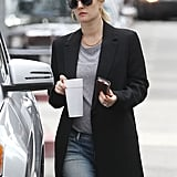 Drew Barrymore walked to her car in a long black jacket, reportedly hiding a baby bump.